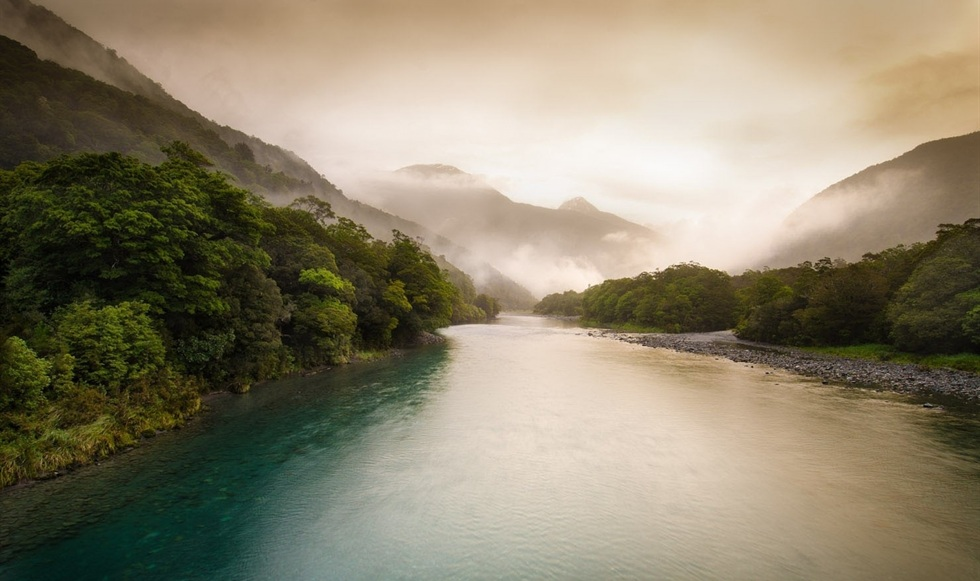 big-river-flowing-into-foggy-mountain-air-preview